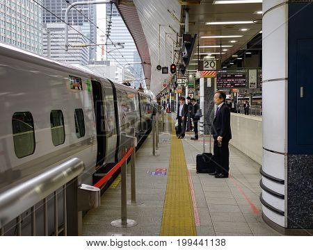 People At Railway Station In Tokyo, Japan