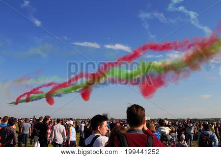 Moscow Region - July 21 2017: Multicolored smoke of the colors of the flag of the United Arab Emirates after the flight of the aerobatic team.
