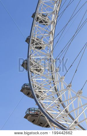 LONDON UNITED KINGDOM JUNE 21 2017: View on London Eye on a sunny day. It was erected in 1999 is the most popular paid tourist attraction in the UK with over 3.75 million visitors annually