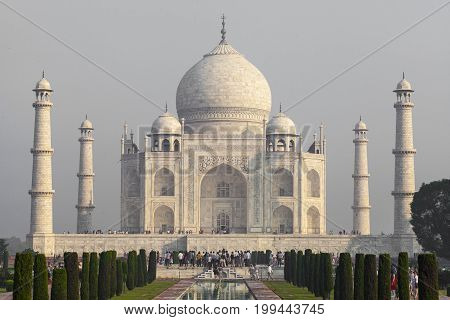 Amazing View On The Taj Mahal In Sunset Light With Reflection In Water. The Taj Mahal Is An Ivory-wh