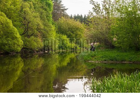 Fisherman In Water. Fishing At The River