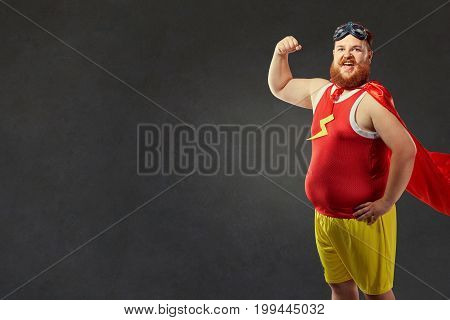 A funny fat man in a superhero costume.