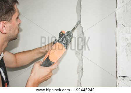 Construction Concept. An Electrician Holds