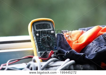Construction Concept. Multimeter And Work Suit