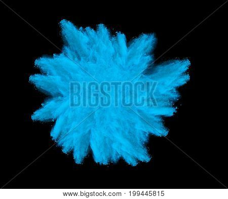 Freeze motion of blue dust explosion isolated on black background.