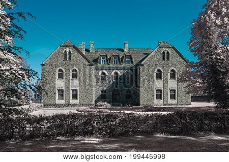 Old stoned building in Cesis, Latvia. Infrared photography, color swapped process.