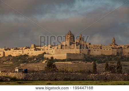 Ancient hilltop fortified capital city of Malta, The Silent City, Mdina or L-Imdina, skyline at sunrise.