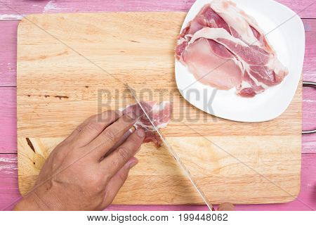 Chef sicing pork for cooking / Cooking Yakisoba concept