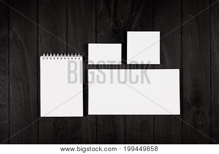 Corporate identity template stationery on black stylish wood background. Mock up for branding graphic designers presentations and portfolios.