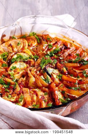 Baked vegetables in tomato sauce in a tin