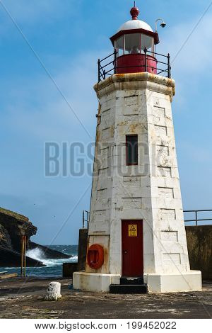 Lybster Harbour Lighthouse at the end of the quay Caithness. Small fishing village in the north of Scotland