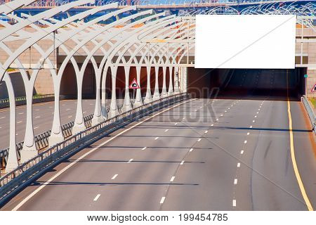Tunnel on highway with blank billboard over it. Copy space on billboard