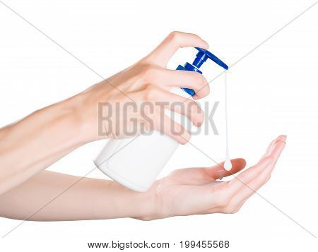 Woman Hands Pushing Soap Dispenser With Soap Drop