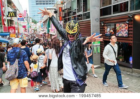 Tokyo, Japan - August 10, 2016: People, mostly youngsters, walk through Takeshita Dori near Harajuku train station on August 10, 2016. Takeshita Dori is modern Japan's fashion trends.