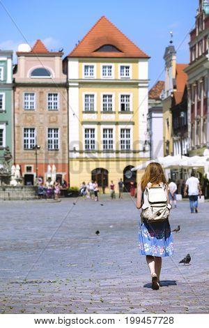 Girl Walk At The Main Square Rynek Of Poznan