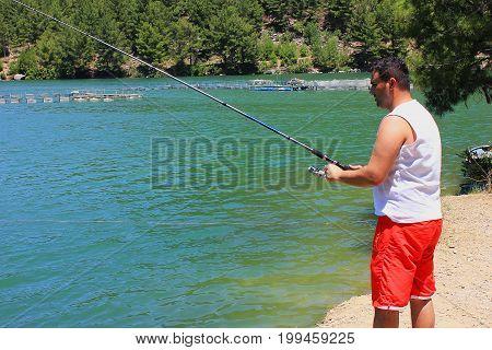 Fisherman on the lake in Antalya Turkey. Summer, water, fishing