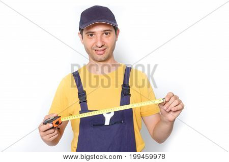 Worker Holding A Tape Measure Isolated On White