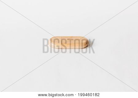 Closed Wooden Usb Flash Drive On A White Isolated Background. Copy Space. Front View