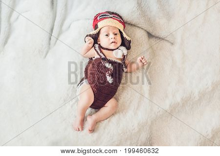 Cute Smiling Baby In The Cap Of The Pilot Is Flying On A White Background