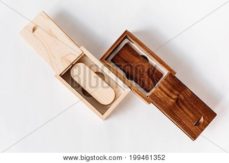 Two Packaging For Usb Drives. Wooden Box With Usb-stick For A Photographer, On A White Isolated Back