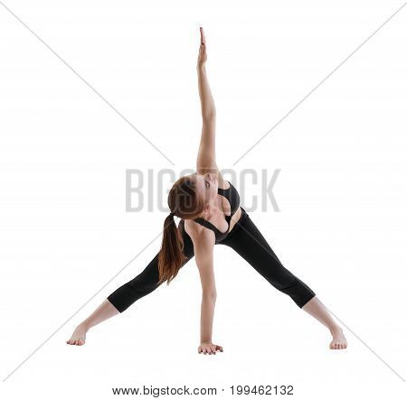 Yuong girl in black top and leggings doing yoga posing isolated view