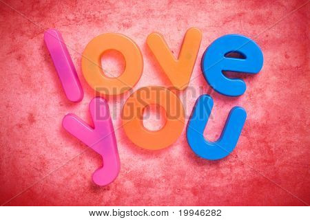 """the words """"love you"""" written with colorful letter magnets. poster"""