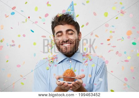 Look At This Tasty Cake! Pleased Man With Thick Beard And Broad Smile, Holding Plate With Little Del