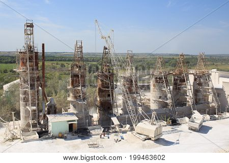 Plant for processing chalk raw material, High containers, tanks, cranes. Quarry for mining chalk