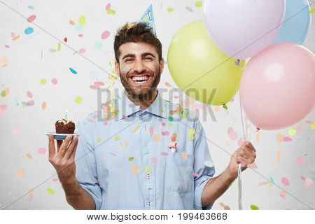 People, Joy, Fun And Happiness Concept. Relaxed Happy Birthday Guy Looking Cheerful, Smiling Happily
