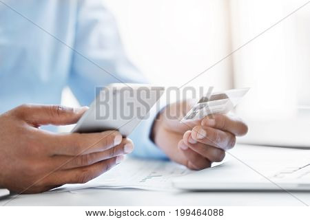 Cropped Shot Of Businessman Holding Modern Cell Phone And Credit Card In Hands, Making Transaction U
