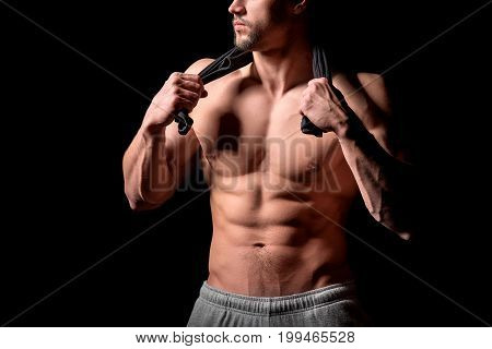Muscular and sexy torso of young man having perfect abs, bicep and chest. Male hunk with athletic body. Fitness concept.