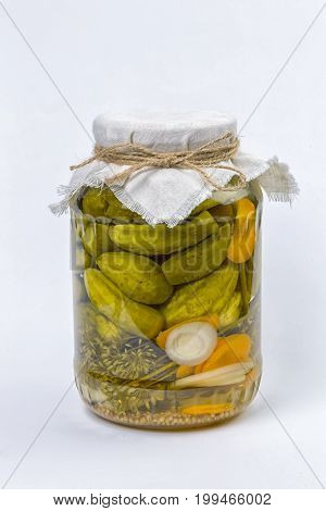 Pickled cucumbers, marinating in jars on a white background