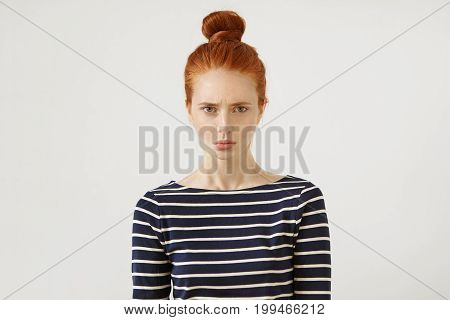 Discontent Redhead Teenage Girl Wearing Casual Striped Sweater, Having Gloomy Expression After Faili