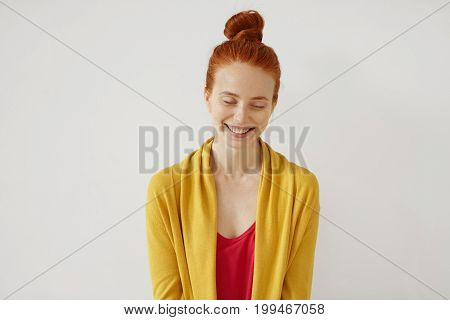 Portrait Of Young Female Model Closing Her Eyes And Smiling Broadly While Feeling Joy. Red-haired Gi