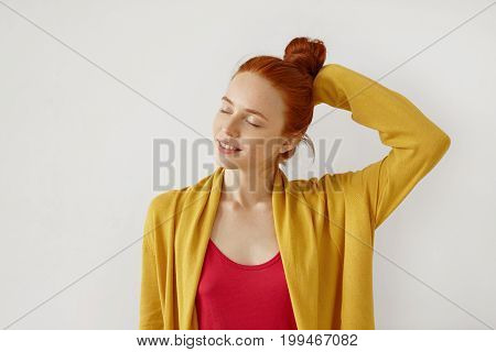 Carefree Female With Ginger Bun, Freckled Pure Skin, Closing Her Eyes While Feeling Enjoyment, Keepi