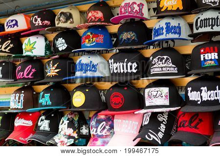 LOS ANGELES CA - JUNE 19 2017: Display of caps hats for sale on sidewalk outside a souvenir shop in Venice Beach