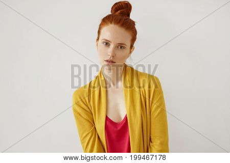 Serious Assured Good-looking Girl, Having Red Hair Bun, Freckled Skin, Thin Lips And Green Eyes, Wea