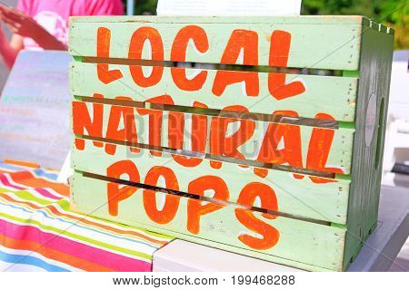 Sign Local natural pops at Farmer's Market.