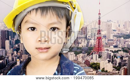 Engineering boy with tokyo city in the background for future education concept