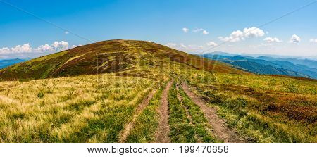 Panorama With Dirt Road Through Mountain Ridge