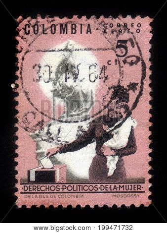 Colombia - circa 1964: A stamp printed in Colombia shows mother and children at the polling station, issued to publicize women's political rights, circa 1964