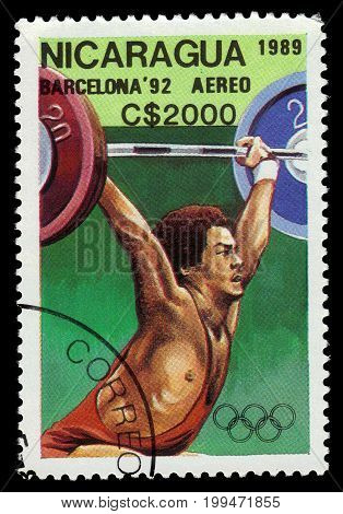 Nicaragua - circa 1989: A stamp printed in Nicaragua shows weightlifter, weightlifting, Olympic Games 1992 - Barcelona, circa 1989