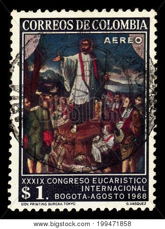 Colombia - circa 1968: A stamp printed in Colombia shows preaching of Saint Francis Xavier, painting by G.Vasquez, series 39th eucharistic congress, circa 1968