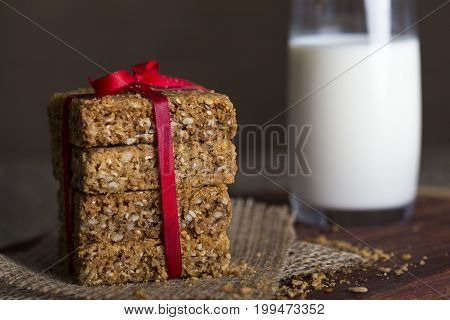 Stack of oatmeal crunchy cookies and milk in the background