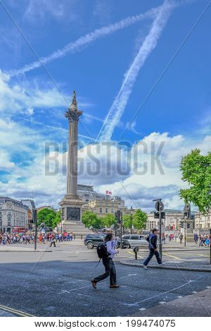London United Kingdom - July 21 2017; Trafalgar Square with Nelson's Column vertical view on a bright summer day.