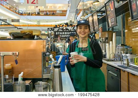 SAINT PETERSBURG, RUSSIA - CIRCA AUGUST, 2017: indoor portrait of staff at Starbucks coffee shop in Saint Petersburg. Starbucks Corporation is an American coffee company and coffeehouse chain.
