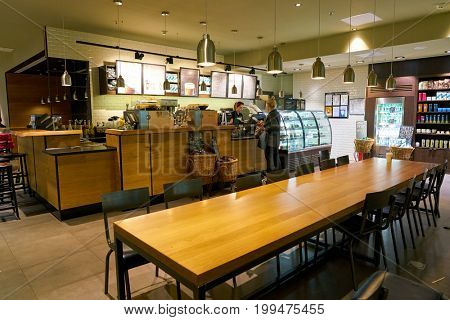 SAINT PETERSBURG, RUSSIA - CIRCA AUGUST, 2017: inside Starbucks coffee shop at Pulkovo airport. Starbucks Corporation is an American coffee company and coffeehouse chain.