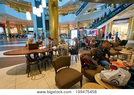 SAINT PETERSBURG, RUSSIA - CIRCA AUGUST, 2017: Starbucks coffee shop at Galeria shopping center. Starbucks Corporation is an American coffee company and coffeehouse chain.