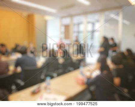 Education Or Business Concept Of Blurred Image Of People Brandstorming And Discussion During Worksho