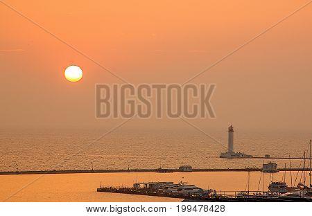 Lighthouse on the sea during the dawn. Odessa, Black sea, Ukraine.